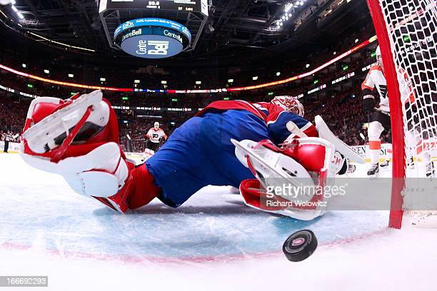Scott Hartnell of the Philadelphia Flyers tips in the puck past Carey Price of the Montreal Canadiens during the NHL game at the Bell Centre on April...