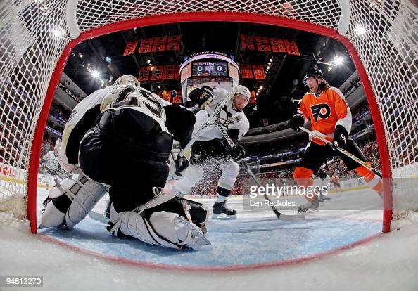 Scott Hartnell of the Philadelphia Flyers waits for a tip in shot on goal against MarcAndre Fleury and Sergei Gonchar of the Pittsburgh Penguins on...