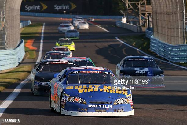 Scott Heckert driver of the Project Lifesaver Chevrolet leads a pack of cars during the KN Pro Series East Bully Hill Vineyards 125 at Watkins Glen...