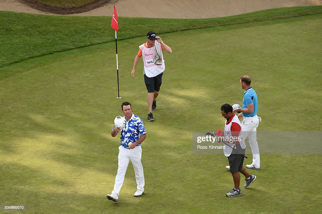 <a gi-track='captionPersonalityLinkClicked' href=/galleries/search?phrase=Scott+Hend&family=editorial&specificpeople=561652 ng-click='$event.stopPropagation()'>Scott Hend</a> of Australia acknowledges the crowd on the 18th green during day three of the BMW PGA Championship at Wentworth on May 28, 2016 in Virginia Water, England.
