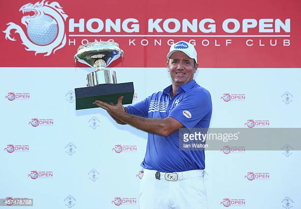 Scott Hend of Australia celebrates with the trophy after winning the final round of the 2014 Hong Kong open at The Hong Kong Golf Club on October 19...