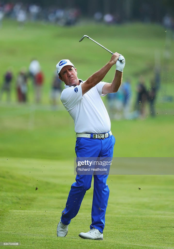 <a gi-track='captionPersonalityLinkClicked' href=/galleries/search?phrase=Scott+Hend&family=editorial&specificpeople=561652 ng-click='$event.stopPropagation()'>Scott Hend</a> of Australia hits his 2nd shot on the 17th hole during day two of the BMW PGA Championship at Wentworth on May 27, 2016 in Virginia Water, England.