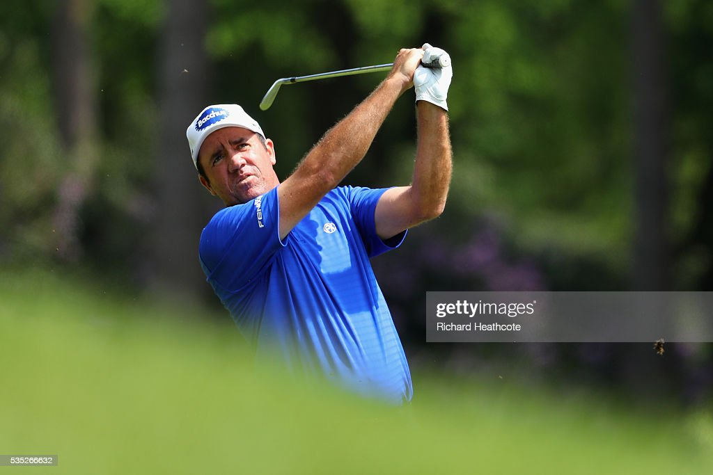 Scott Hend of Australia hits his 2nd shot on the 6th hole during day four of the BMW PGA Championship at Wentworth on May 29, 2016 in Virginia Water, England.