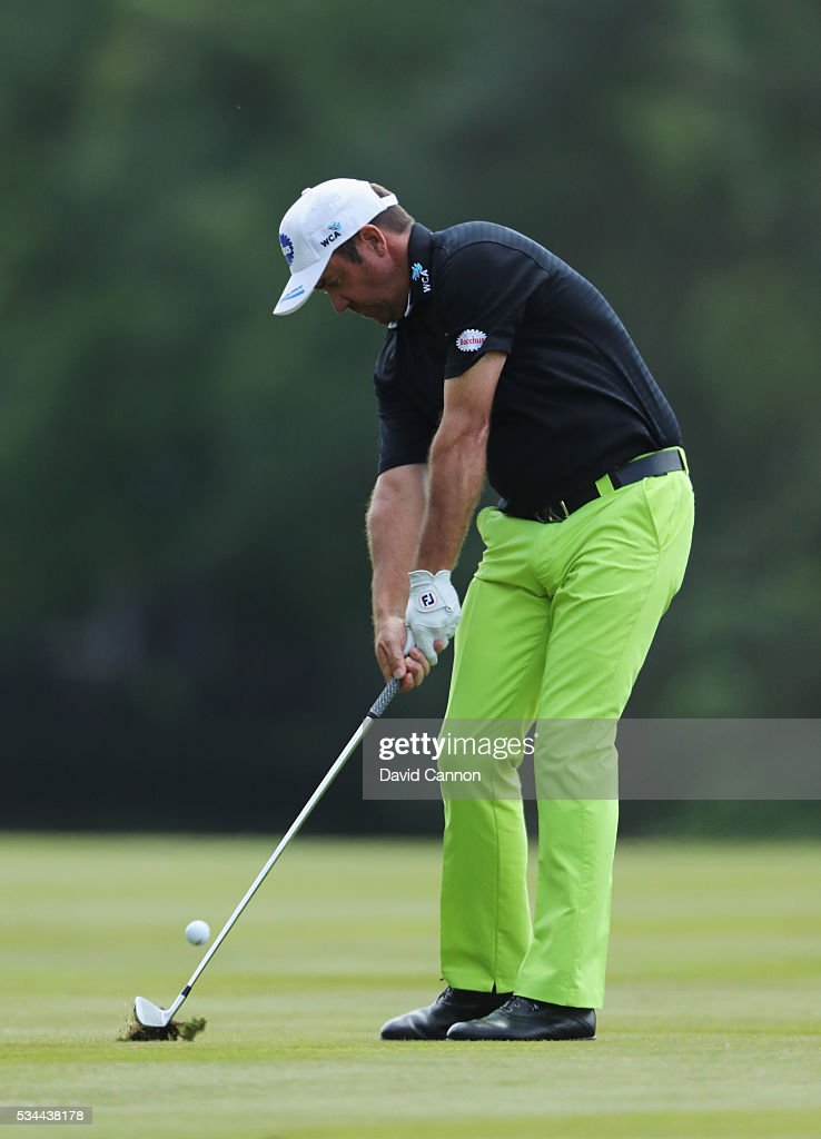 <a gi-track='captionPersonalityLinkClicked' href=/galleries/search?phrase=Scott+Hend&family=editorial&specificpeople=561652 ng-click='$event.stopPropagation()'>Scott Hend</a> of Australia hits his 2nd shot on the 9th hole during day one of the BMW PGA Championship at Wentworth on May 26, 2016 in Virginia Water, England.
