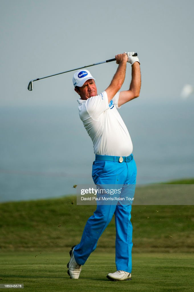 <a gi-track='captionPersonalityLinkClicked' href=/galleries/search?phrase=Scott+Hend&family=editorial&specificpeople=561652 ng-click='$event.stopPropagation()'>Scott Hend</a> of Australia hits his second shot on the 18th hole during round three of the Venetian Macau Open on October 19, 2013 at the Macau Golf & Country Club in Macau. The Asian Tour tournament offers a record US$ 800,000 prize money which goes through October 20.