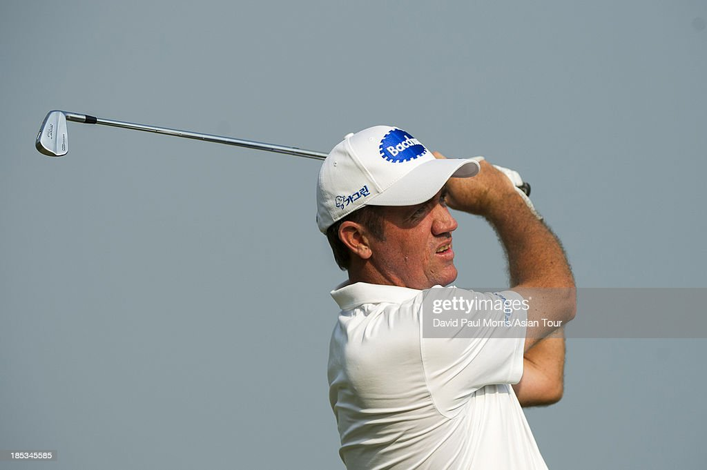 <a gi-track='captionPersonalityLinkClicked' href=/galleries/search?phrase=Scott+Hend&family=editorial&specificpeople=561652 ng-click='$event.stopPropagation()'>Scott Hend</a> of Australia hits his tee shot on the 17th hole during round three of the Venetian Macau Open on October 19, 2013 at the Macau Golf & Country Club in Macau. The Asian Tour tournament offers a record US$ 800,000 prize money which goes through October 20.