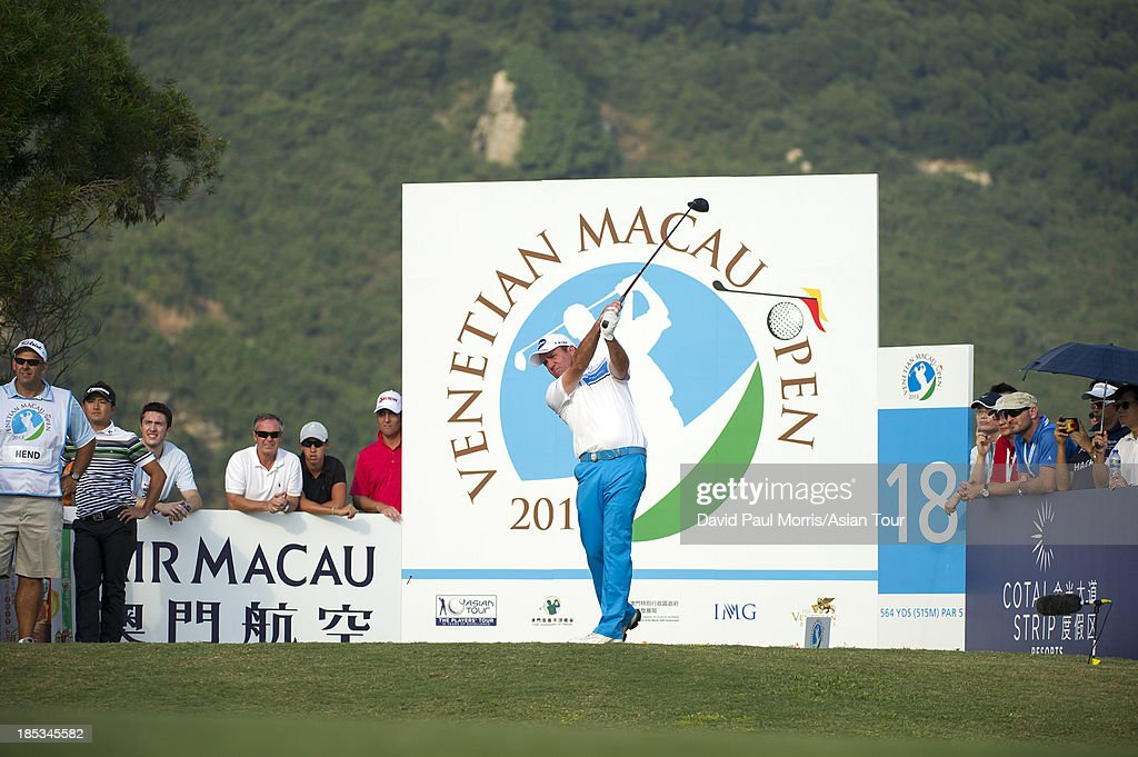 Scott Hend of Australia hits his tee shot on the 18th hole during round three of the Venetian Macau Open on October 19, 2013 at the Macau Golf & Country Club in Macau. The Asian Tour tournament offers a record US$ 800,000 prize money which goes through October 20.