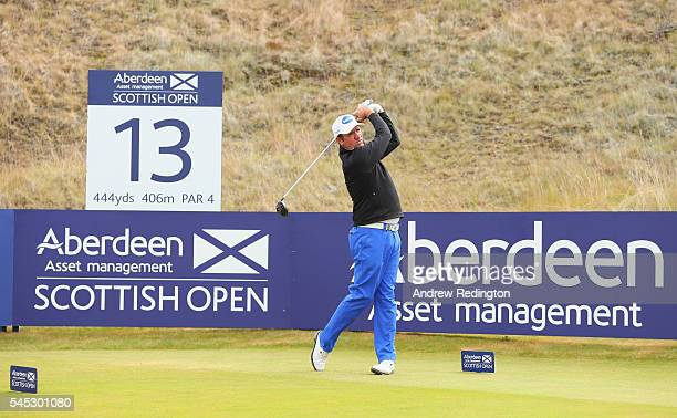 Scott Hend of Australia hits his teeshot on the 13th hole during the first round of the AAM Scottish Open at Castle Stuart Golf Links on July 7 2016...