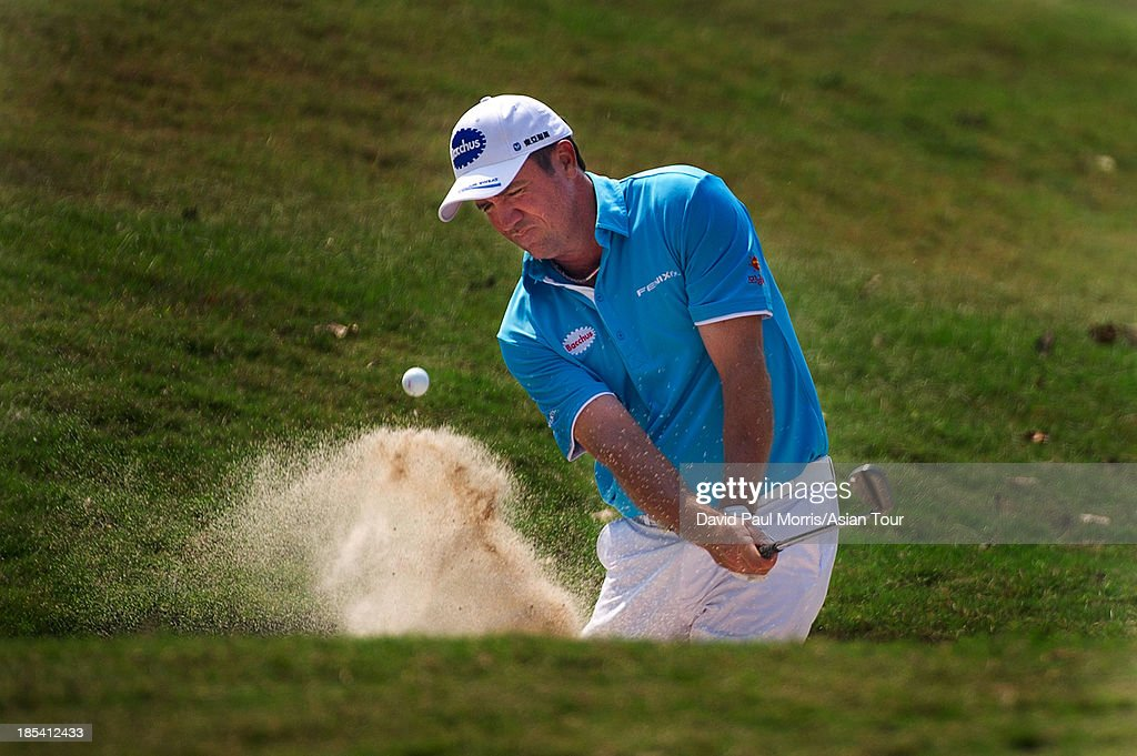 Scott Hend of Australia hits out of the bunker on the 1st hole during round four of the Venetian Macau Open on October 20, 2013 at the Macau Golf & Country Club in Macau. The Asian Tour tournament offers a record US$ 800,000 prize money which goes through October 20.