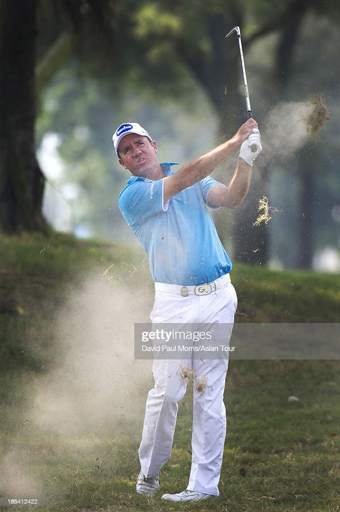 Scott Hend of Australia hits out of the rough on the 1st hole during round four of the Venetian Macau Open on October 20, 2013 at the Macau Golf & Country Club in Macau. The Asian Tour tournament offers a record US$ 800,000 prize money which goes through October 20.