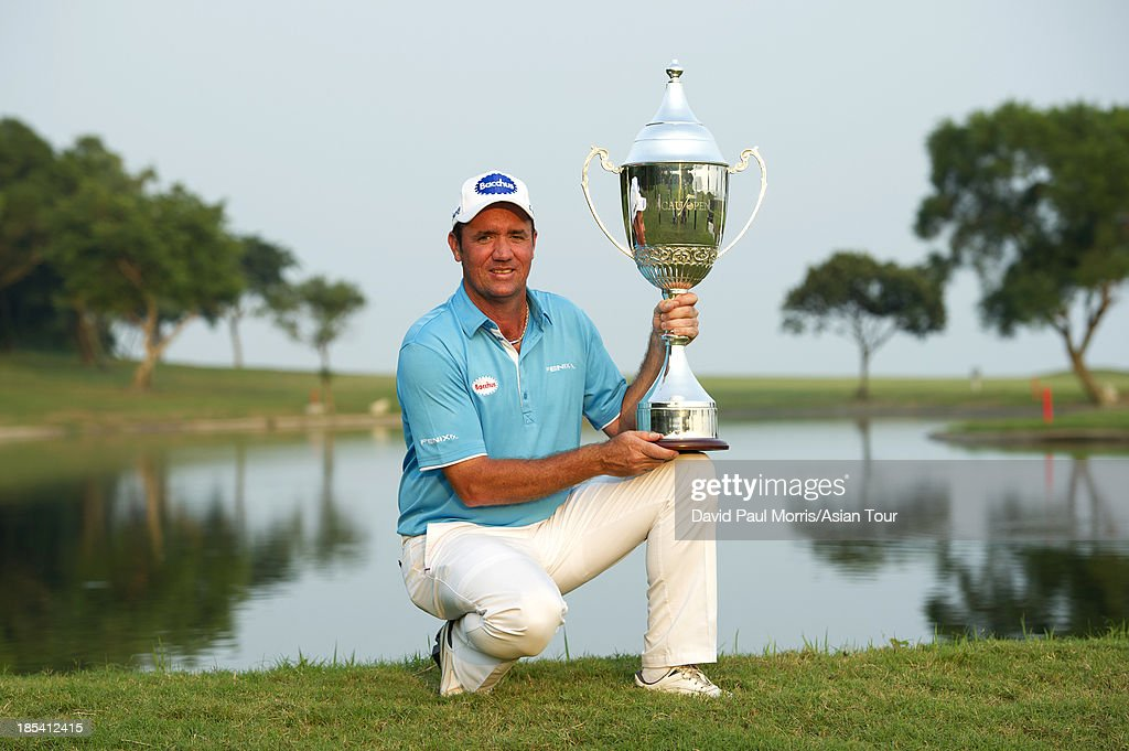 <a gi-track='captionPersonalityLinkClicked' href=/galleries/search?phrase=Scott+Hend&family=editorial&specificpeople=561652 ng-click='$event.stopPropagation()'>Scott Hend</a> of Australia holds the trophy after winning the 2013 Venetian Macau Open on October 20, 2013 at the Macau Golf & Country Club in Macau. Hend finished with a 16 under par 268 taking home US$ 144,000.