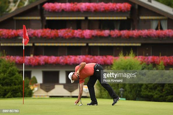Scott Hend of Australia holes out on the 14th hole during the final round of the Omega European Masters at CranssurSierre Golf Club on September 4...