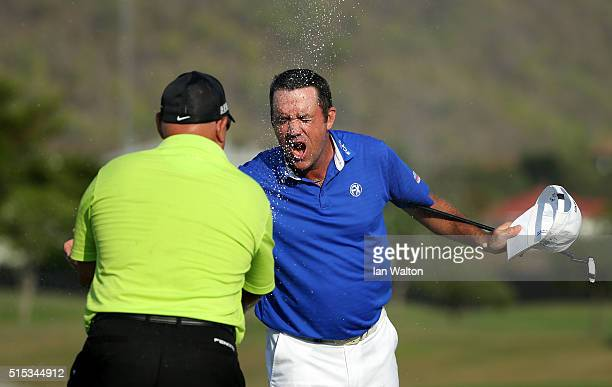 Scott Hend of Australia is sprayed with champagne after winning during the final round on day four of the Thailand Classic at Black Mountain Golf...