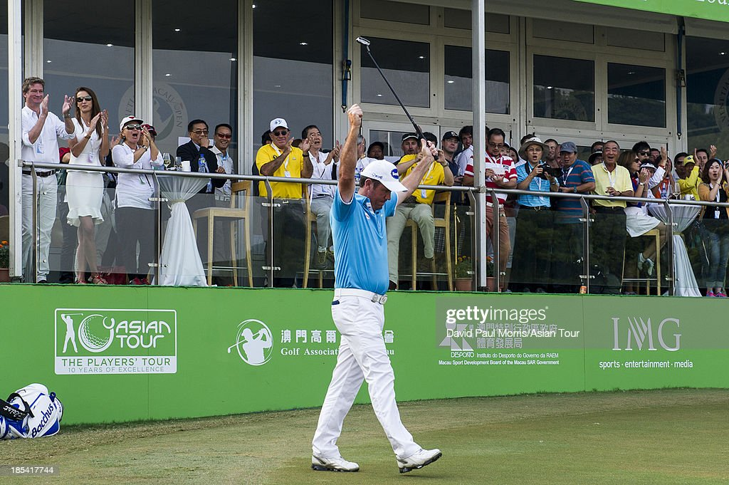 Scott Hend of Australia lifts his arms in victory after wining the 2013 Venetian Macau Open on October 20, 2013 at the Macau Golf & Country Club in Macau. The Asian Tour tournament offers a record US$ 800,000 prize money which goes through October 20.