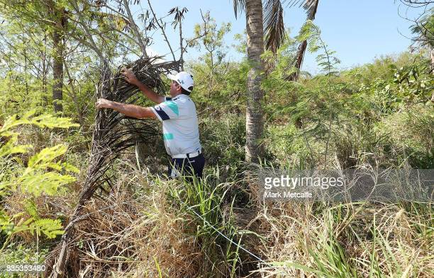 Scott Hend of Australia moves loose items in the rough on the 11th hole during day three of the 2017 Fiji International at Natadola Bay Championship...