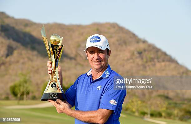 Scott Hend of Australia pictured with the winner's trophy during round four of the True Thailand Classic presented by Chang at Black Mountain Golf...