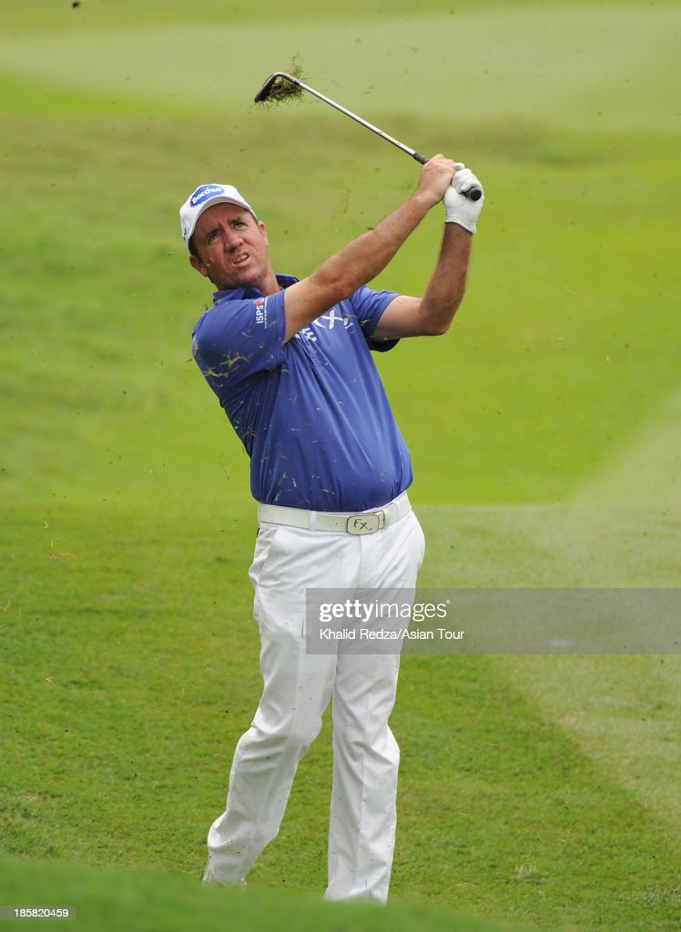 <a gi-track='captionPersonalityLinkClicked' href=/galleries/search?phrase=Scott+Hend&family=editorial&specificpeople=561652 ng-click='$event.stopPropagation()'>Scott Hend</a> of Australia plays a shot during round two of the CIMB Classic at Kuala Lumpur Golf & Country Club on October 25, 2013 in Kuala Lumpur, Malaysia.
