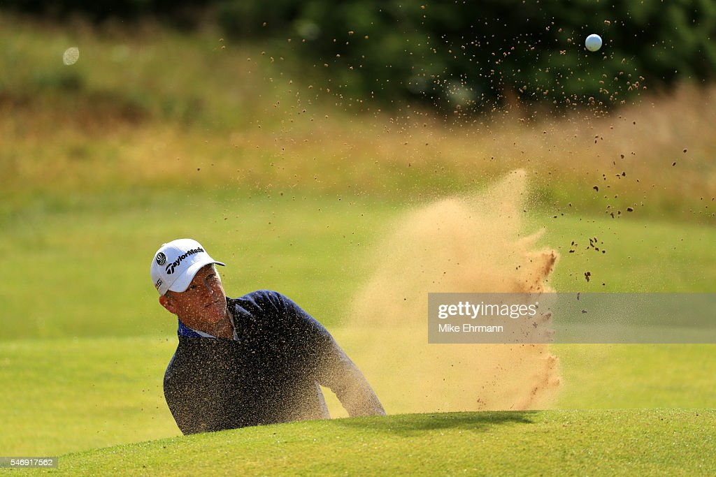 Scott Hend of Australia plays a shot from a bunker on the 14th hole during a practice round ahead of the 145th Open Championship at Royal Troon on...