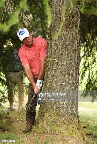 Scott Hend of Australia plays his second shot on the 14th hole during the final round of the Omega European Masters at CranssurSierre Golf Club on...