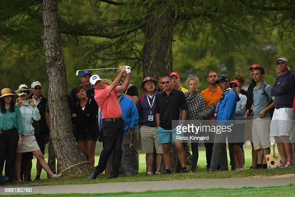 Scott Hend of Australia plays his second shot on the 18th hole during the final round of the Omega European Masters at CranssurSierre Golf Club on...