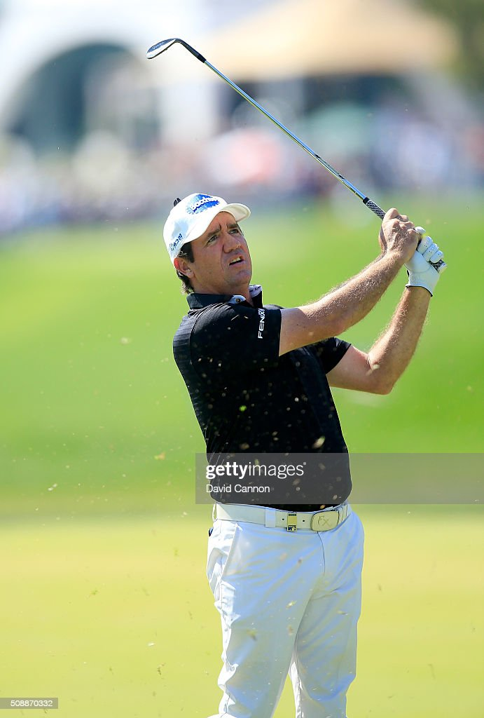 <a gi-track='captionPersonalityLinkClicked' href=/galleries/search?phrase=Scott+Hend&family=editorial&specificpeople=561652 ng-click='$event.stopPropagation()'>Scott Hend</a> of Australia plays his third shot at the par 4, first hole during the final round of the 2016 Omega Dubai Desert Classic on the Majlis Course at the Emirates Golf Club on February 7, 2016 in Dubai, United Arab Emirates.