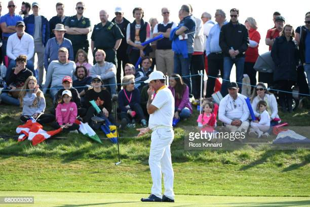 Scott Hend of Australia reacts to a missed putt on the 6th green during the final match between Denmark and Australia during day two of GolfSixes at...