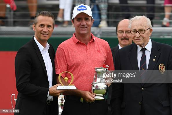 Scott Hend of Australia receives his runners up prize following the final round of the Omega European Masters at CranssurSierre Golf Club on...