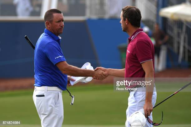 Scott Hend of Australia shakes hands with Alexander Bjork of Sweden on the 18th green during the first round of the DP World Tour Championship at...