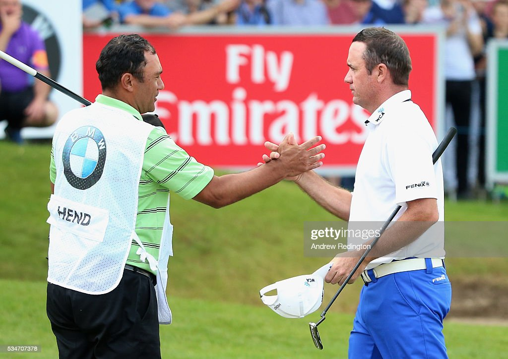 <a gi-track='captionPersonalityLinkClicked' href=/galleries/search?phrase=Scott+Hend&family=editorial&specificpeople=561652 ng-click='$event.stopPropagation()'>Scott Hend</a> of Australia shakes hands with his caddie on the 18th green during day two of the BMW PGA Championship at Wentworth on May 27, 2016 in Virginia Water, England.