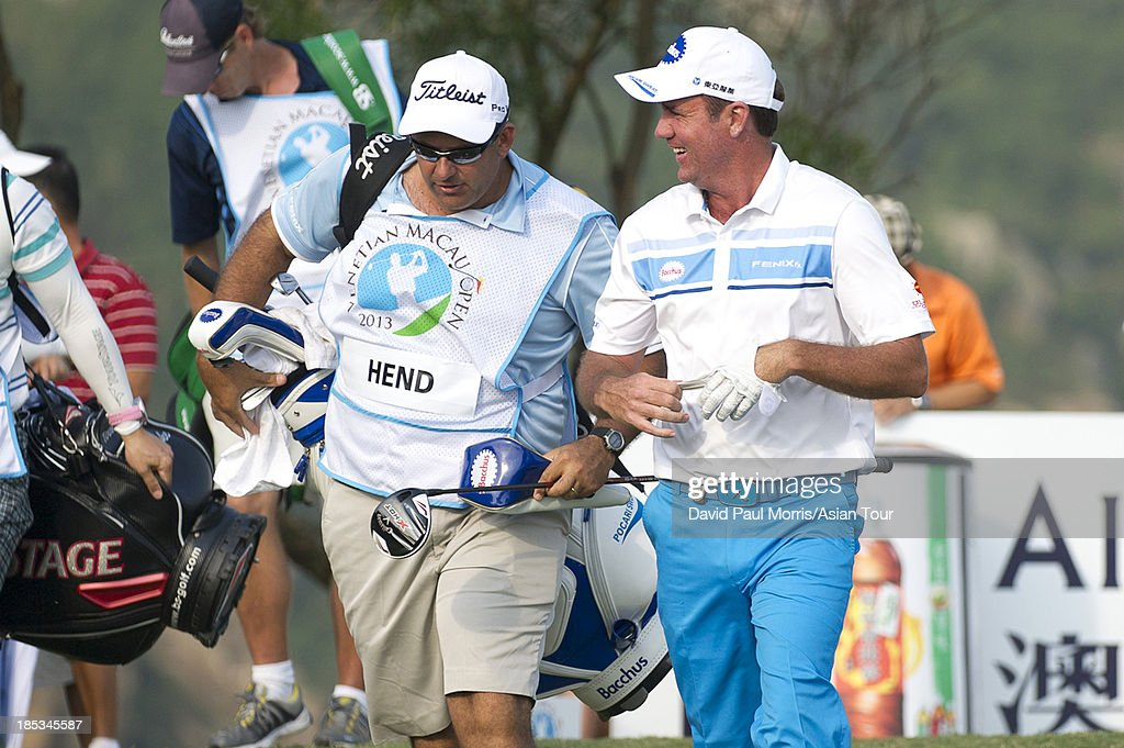 Scott Hend of Australia shares a laugh with his caddy after teeing off on the 18th hole during round three of the Venetian Macau Open on October 19, 2013 at the Macau Golf & Country Club in Macau. The Asian Tour tournament offers a record US$ 800,000 prize money which goes through October 20.