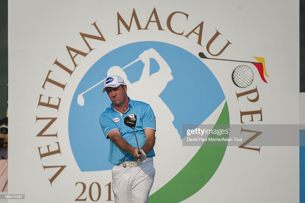<a gi-track='captionPersonalityLinkClicked' href=/galleries/search?phrase=Scott+Hend&family=editorial&specificpeople=561652 ng-click='$event.stopPropagation()'>Scott Hend</a> of Australia tees off on the 18th hole during round four of the Venetian Macau Open on October 20, 2013 at the Macau Golf & Country Club in Macau. The Asian Tour tournament offers a record US$ 800,000 prize money which goes through October 20.