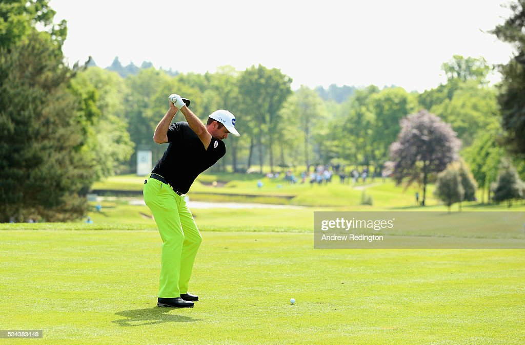 <a gi-track='captionPersonalityLinkClicked' href=/galleries/search?phrase=Scott+Hend&family=editorial&specificpeople=561652 ng-click='$event.stopPropagation()'>Scott Hend</a> of Australia tees off on the 8th hole during day one of the BMW PGA Championship at Wentworth on May 26, 2016 in Virginia Water, England.