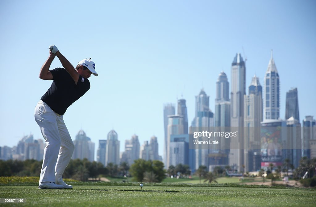 <a gi-track='captionPersonalityLinkClicked' href=/galleries/search?phrase=Scott+Hend&family=editorial&specificpeople=561652 ng-click='$event.stopPropagation()'>Scott Hend</a> of Australia tees off on the 8th hole during the final round of the Omega Dubai Desert Classic at the Emirates Golf Club on February 7, 2016 in Dubai, United Arab Emirates.