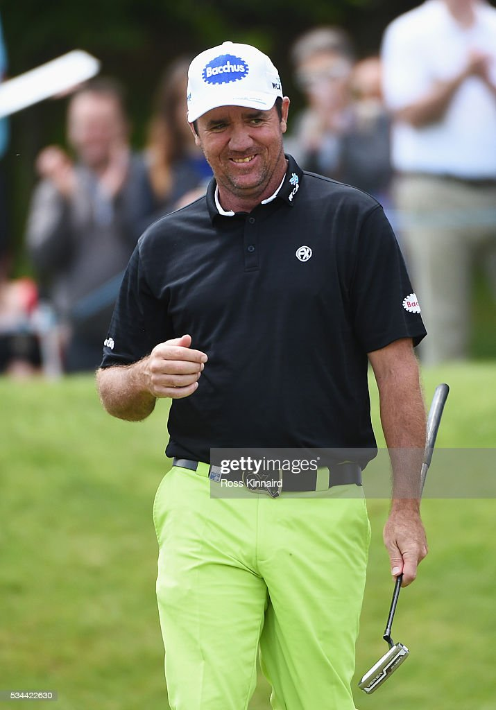 Scott Hend of Australia walks on to the 18th green during day one of the BMW PGA Championship at Wentworth on May 26, 2016 in Virginia Water, England.