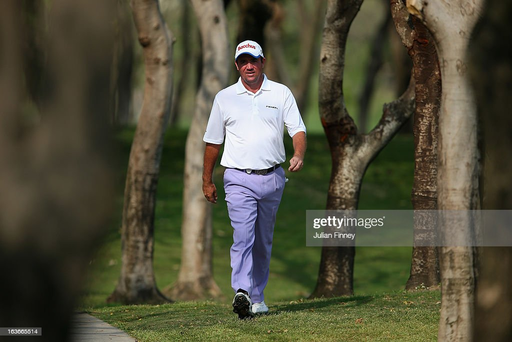 <a gi-track='captionPersonalityLinkClicked' href=/galleries/search?phrase=Scott+Hend&family=editorial&specificpeople=561652 ng-click='$event.stopPropagation()'>Scott Hend</a> of Australia walks through the trees to find his ball during day one of the Avantha Masters at Jaypee Greens Golf Club on March 14, 2013 in Delhi, India.