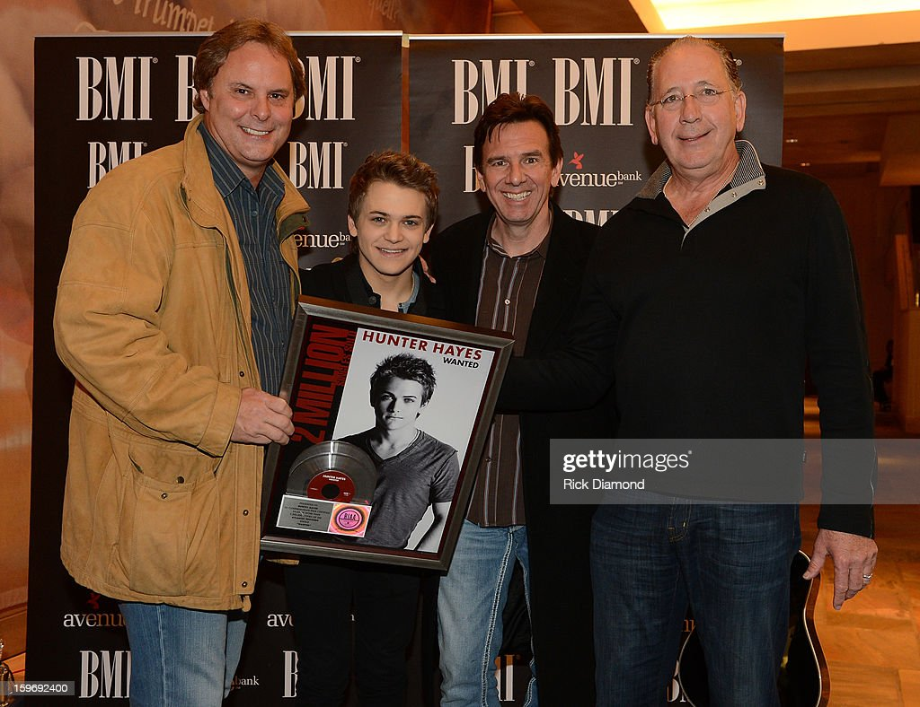 Scott Hendricks Warner Music Nashville, <a gi-track='captionPersonalityLinkClicked' href=/galleries/search?phrase=Hunter+Hayes&family=editorial&specificpeople=3290701 ng-click='$event.stopPropagation()'>Hunter Hayes</a> Singer/Songwriter co-writer, Dann Huff Producer and John Esposito WMN attend the 'Wanted' No 1 Party on January 17, 2013 in Nashville, Tennessee.