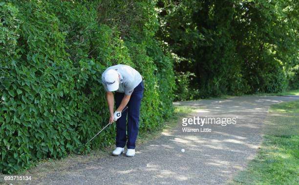 Scott Henry of Scotland plays from the bushes on the 10th hole during day one of the Lyoness Open at Diamond Country Club on June 8 2017 in...