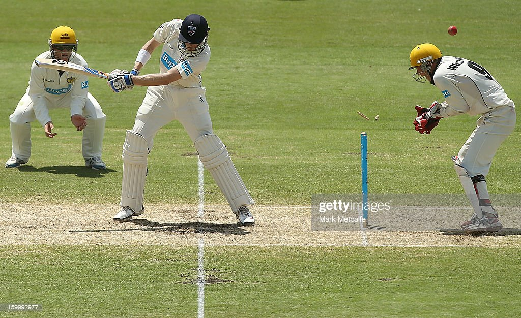 Scott Henry of the Blues is bowled by Ashton Agar of the Warriors during day two of the Sheffield Shield match between the New South Wales Blues and the Western Australia Warriors at Blacktown International Sportspark on January 25, 2013 in Sydney, Australia.