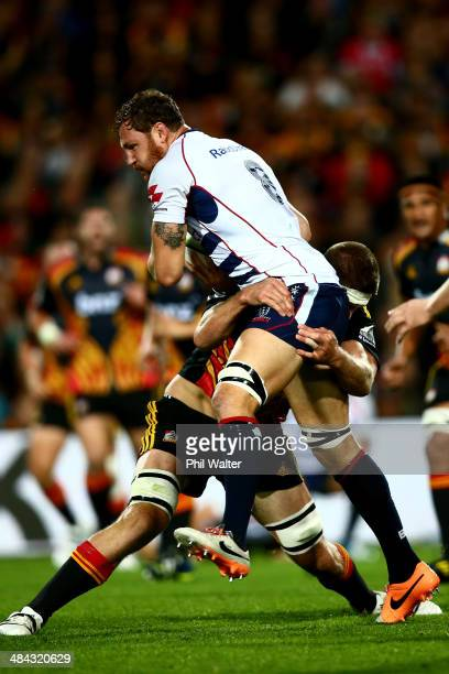 Scott Higginbotham of the Rebels is tackled by Brodie Retallick of the Chiefs during the round nine Super Rugby match between the Chiefs and the...