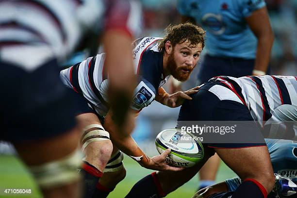 Scott Higginbotham of the Rebels looks for support during the round 11 Super Rugby match between the Waratahs and the Rebels at ANZ Stadium on April...