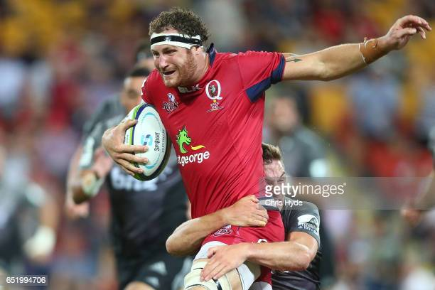 Scott Higginbotham of the Reds makes a break during the round three Super Rugby match between the Reds and the Crusaders at Suncorp Stadium on March...