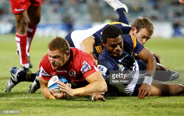 Scott Higginbotham of the Reds scores during the round three Super Rugby match between the Brumbies and the Reds at Canberra Stadium on March 5 2011...