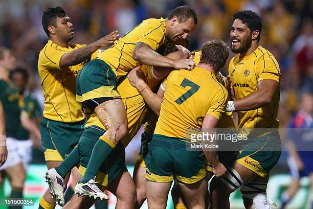 Scott Higginbotham of the Wallabies is congratulated by his team mates after scoring a try during Rugby Championship match between the Australian...