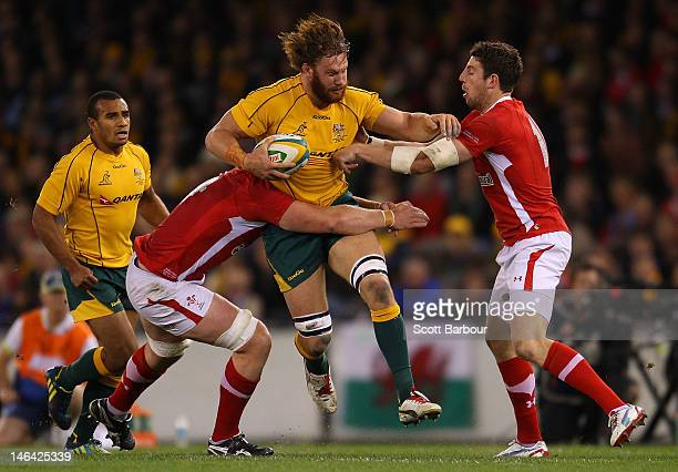 Scott Higginbotham of the Wallabies is tackled during the International Test Match between the Australian Wallabies and Wales at Etihad Stadium on...