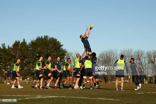 Scott Higginbotham of the Wallabies jumps at the lineout during an Australian Wallabies training session at Bathurst Bulldogs RUFC on August 7 2014...