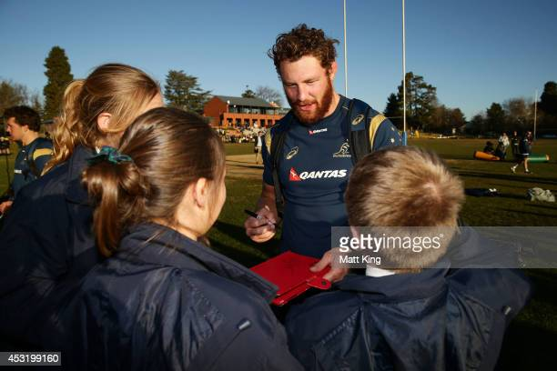 Scott Higginbotham of the Wallabies signs autographs for fans during an Australian Wallabies training session at Kinross Wolaroi School on August 5...