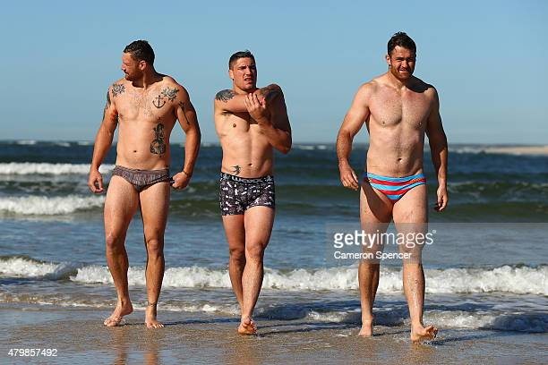 Scott Higginbotham Sean McMahon and James Horwill of the Wallabies walk out of the water at Shelly Beach during an Australian Wallabies recovery...