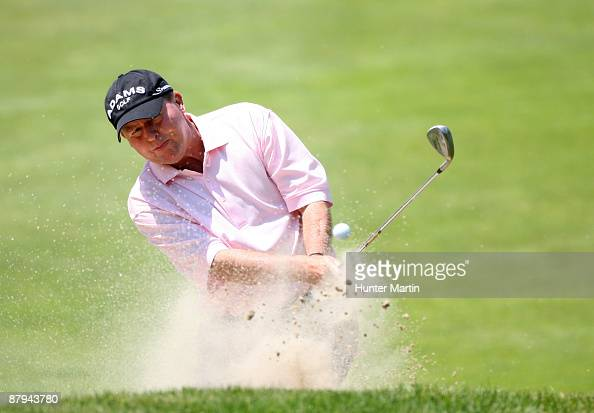 Scott Hoch hits his third shot on the 4th hole during the third round of the 70th Senior PGA Championship at Canterbury Golf Club on May 23 2009 in...