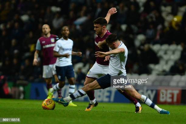 Scott Hogan of Aston Villa and Alan Browne of Preston North End in action during the Sky Bet Championship match between Preston North End and Aston...