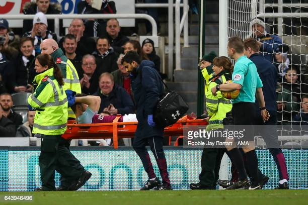 Scott Hogan of Aston Villa goes off injured on a stretcher during the Sky Bet Championship match between Newcastle United and Aston Villa at St...